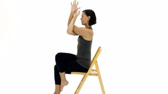 5 Yoga Poses That Seniors Can Do in a Chair - Garudasana arms