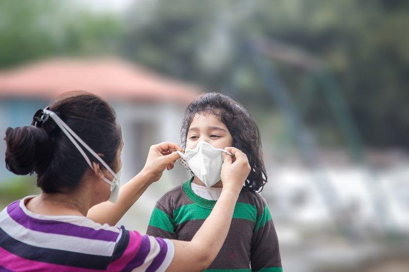 Kid waering a mask- Activ Living
